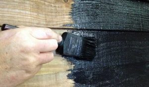 barn paint application by brush